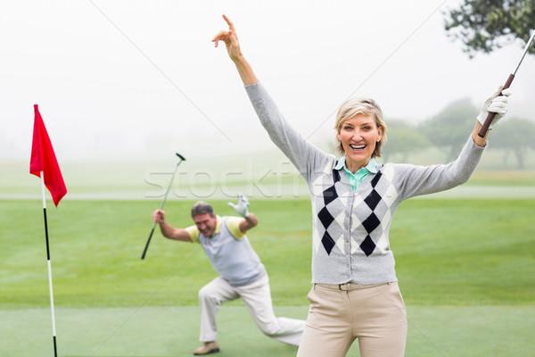 Senhora jogador de golfe câmera parceiro atrás Foto stock © wavebreak_media