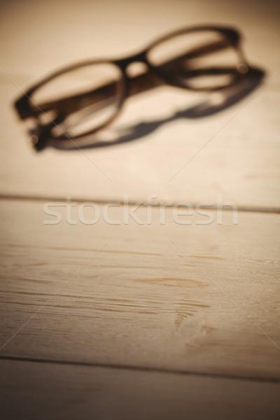 Okulary do czytania biurko działalności biuro tabeli cień Zdjęcia stock © wavebreak_media