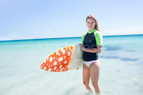 Uygun sarışın kadın ayakta su sörf Stok fotoğraf © wavebreak_media