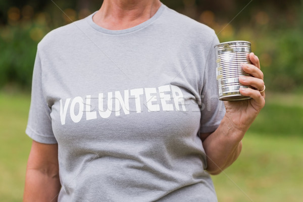 Volunteer holding tin can  Stock photo © wavebreak_media