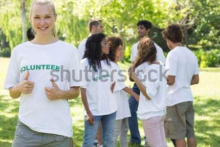 Composite image of smiling volunteer group piling up their hands Stock photo © wavebreak_media