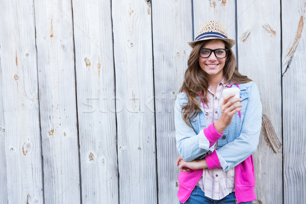 Cute woman holding disposable cup coffee  Stock photo © wavebreak_media