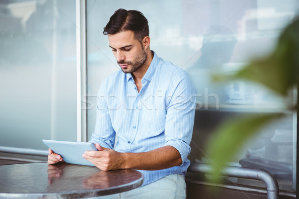 Attentive businessman using a tablet Stock photo © wavebreak_media