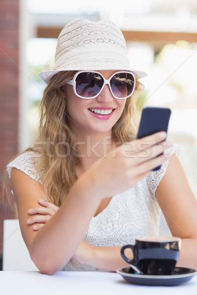 Pretty hipster woman sending a text Stock photo © wavebreak_media