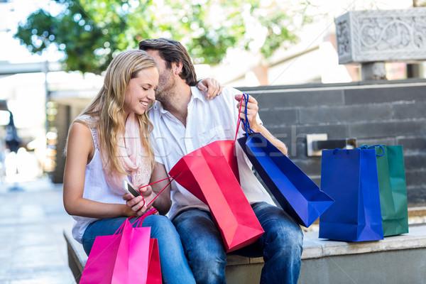 улыбаясь человека целоваться подруга сидят Сток-фото © wavebreak_media