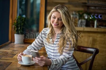 Sonriendo mujer de negocios café planificación semana Servicio Foto stock © wavebreak_media