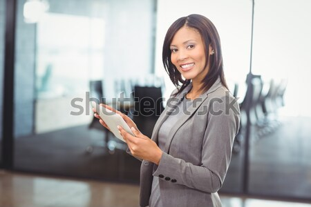 Attractive businesswoman holding digital tablet Stock photo © wavebreak_media