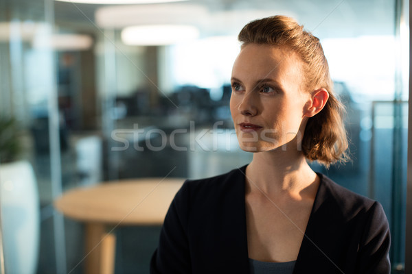 Thoughtful businesswoman looking away Stock photo © wavebreak_media
