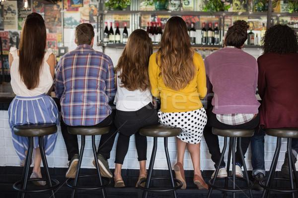 вид сзади друзей сидят ресторан улыбка моде Сток-фото © wavebreak_media