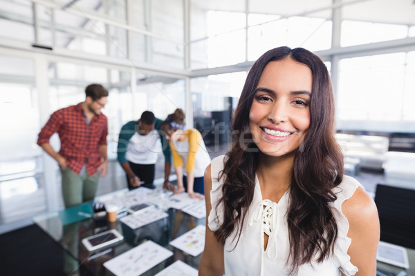 Portrait of businesswoman with colleagues in background Stock photo © wavebreak_media