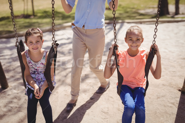 Ritratto sorridere ragazze seduta swing scuola Foto d'archivio © wavebreak_media