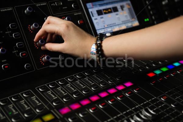 Hand of female audio engineer using sound mixer Stock photo © wavebreak_media