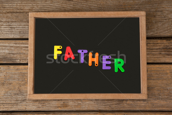 Slate with father text on table Stock photo © wavebreak_media