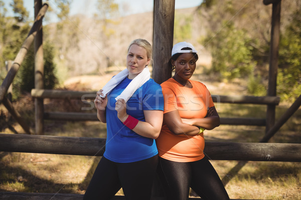 Portrait of happy friends standing with arms crossed during obstacle course Stock photo © wavebreak_media
