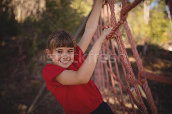 Portré boldog lány mászik net akadályfutás csizma Stock fotó © wavebreak_media