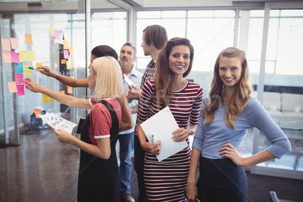 улыбаясь предпринимателей Постоянный коллеги планирования Creative Сток-фото © wavebreak_media