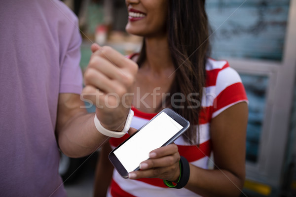 Couple paying bill through smartwatch Stock photo © wavebreak_media
