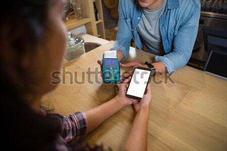 Midsection of man making payment at bar Stock photo © wavebreak_media
