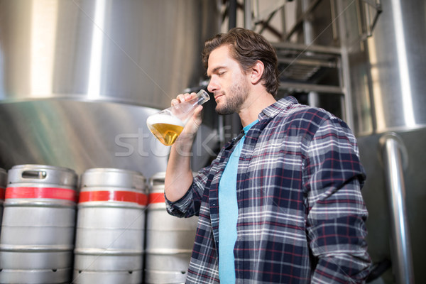 Low angle view of man examining beer Stock photo © wavebreak_media