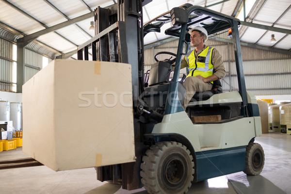 Werknemer pakket heftruck olie fabriek Stockfoto © wavebreak_media