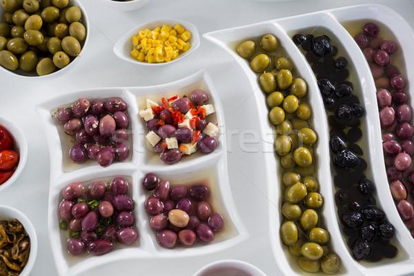 Various pickled olives on white background Stock photo © wavebreak_media