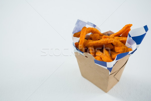 Close up of spicy French fries in carton box Stock photo © wavebreak_media
