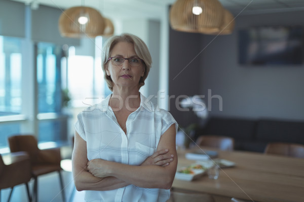 Businesswoman with arms crossed Stock photo © wavebreak_media