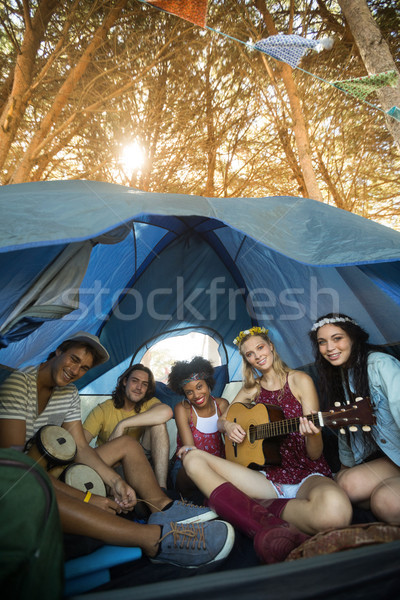 Portrait of happy friends enjoying while sitting in tent Stock photo © wavebreak_media