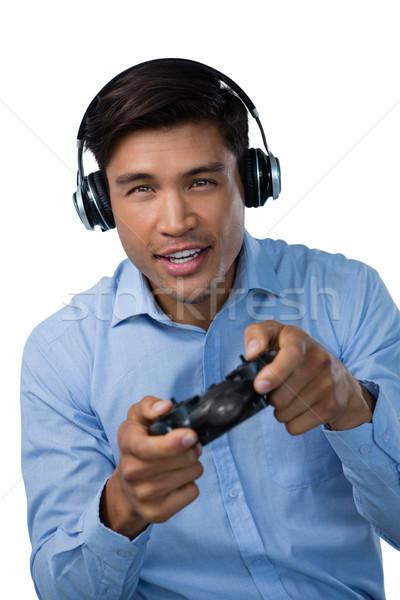 Portre gülen genç işadamı oynama video oyunu Stok fotoğraf © wavebreak_media