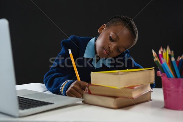 Uczennica praca domowa czarny komputera dziecko edukacji Zdjęcia stock © wavebreak_media
