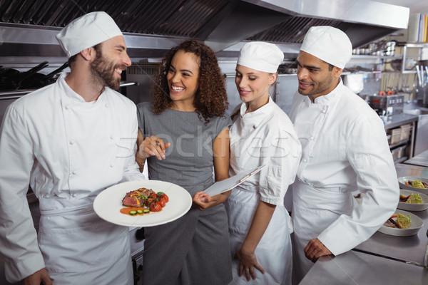 Restaurant manager interacting with his kitchen staff Stock photo © wavebreak_media