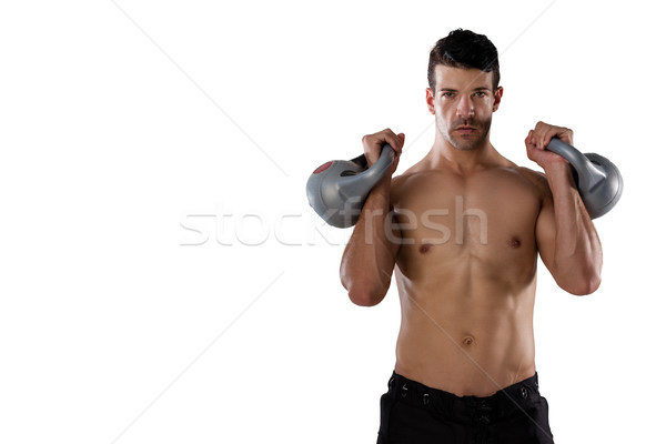 Portrait of shirtless sports player exercising with kettle bells Stock photo © wavebreak_media