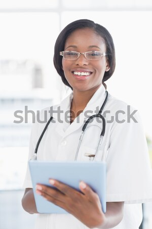 Female doctor talking on mobile phone in nursing home Stock photo © wavebreak_media