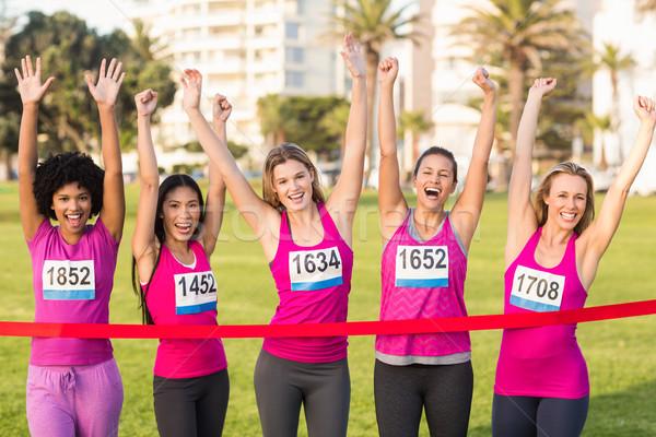 Cheering women supporting breast cancer marathon Stock photo © wavebreak_media