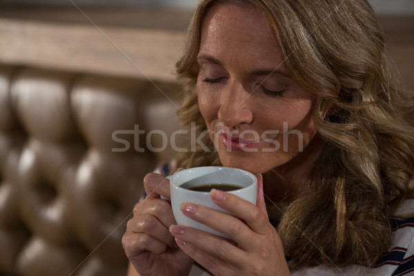 Happy woman smelling coffee Stock photo © wavebreak_media