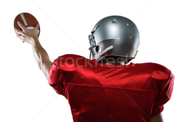 Rear view of American football player in red jersey holding ball Stock photo © wavebreak_media