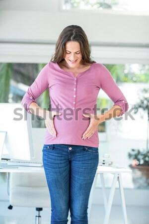 Ritratto felice donna home office donna incinta piedi Foto d'archivio © wavebreak_media