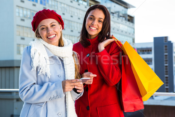 Two girls doing shopping Stock photo © wavebreak_media