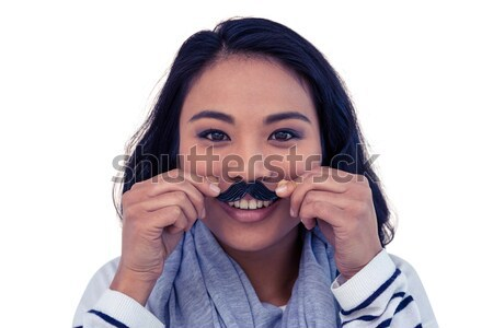 Joli asian femme faux moustache posant Photo stock © wavebreak_media