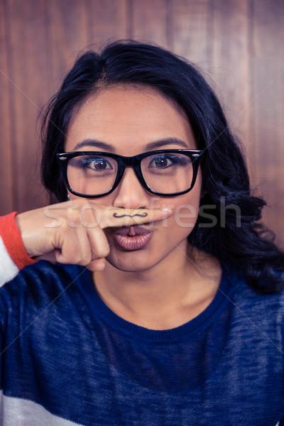 азиатских женщину усы пальца стены Сток-фото © wavebreak_media