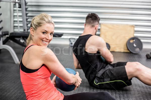 Fitt pár abdominális labda testmozgás crossfit Stock fotó © wavebreak_media