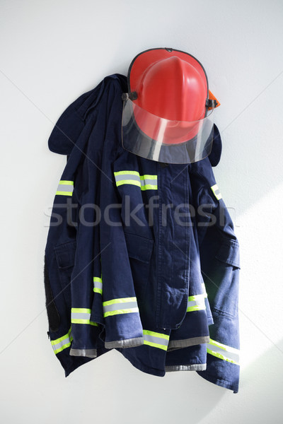 Protective workwear hanging against white wall Stock photo © wavebreak_media
