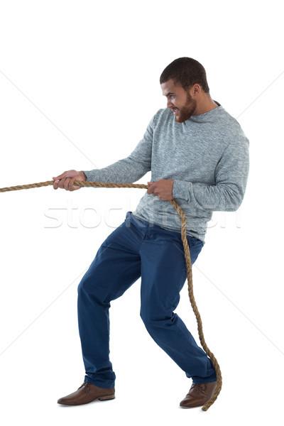 Férfi igazgató húz kötél fehér fiatal Stock fotó © wavebreak_media