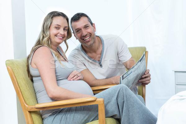 Expecting couple sitting on chair Stock photo © wavebreak_media