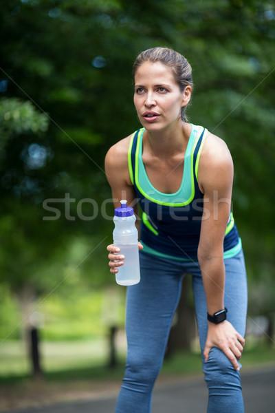 Marathon vrouwelijke atleet lopen drinkwater park Stockfoto © wavebreak_media