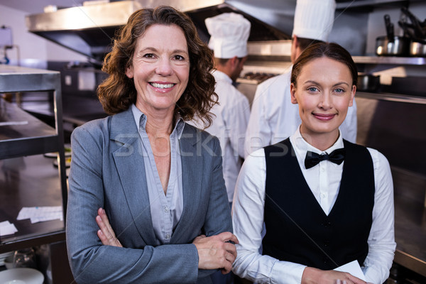 Restaurant manager and waitress smiling in commercial kitchen Stock photo © wavebreak_media