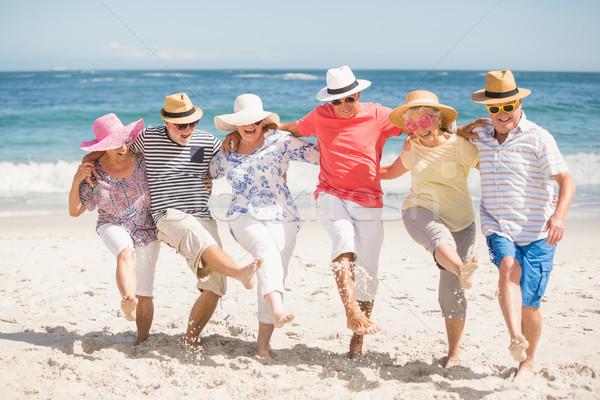 старший друзей танцы пляж женщину Сток-фото © wavebreak_media