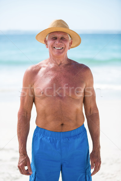 Mature man posing with straw hat Stock photo © wavebreak_media