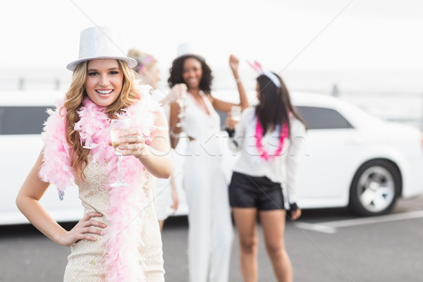 Frivolous women drinking champagne next to a limousine Stock photo © wavebreak_media