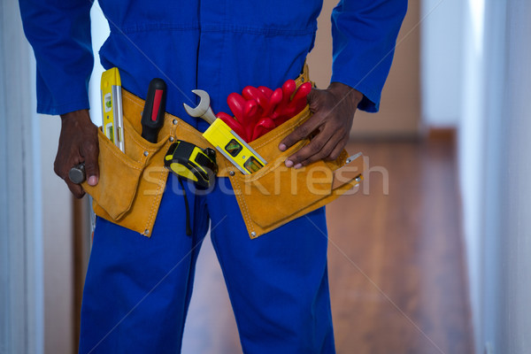 Középső rész férfi visel szerszám öv otthon Stock fotó © wavebreak_media